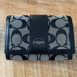 Coach wallet in black print good condition